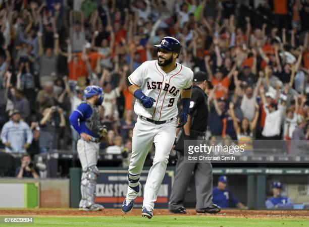 Marwin Gonzalez of the Houston Astros smiles as he rounds the bases after hitting a grans slam during the eighth inning against the Houston Astros at...