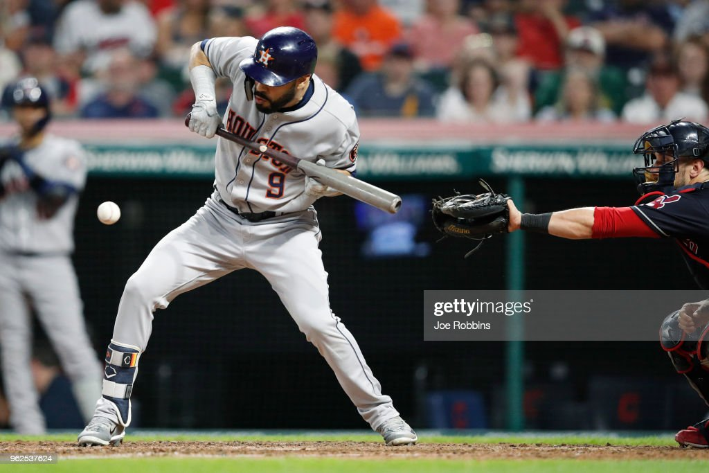 Marwin Gonzalez #9 of the Houston Astros squeeze bunt to drive in the go ahead run in the eighth inning against the Cleveland Indians at Progressive Field on May 25, 2018 in Cleveland, Ohio.