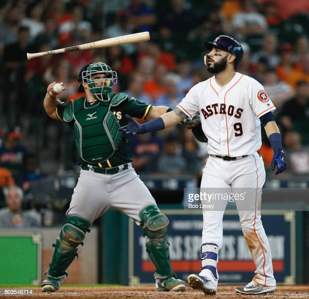 Marwin Gonzalez of the Houston Astros strikes out in the eighth inning as Josh Phegley of the Oakland Athletics throws the ball back at Minute Maid...