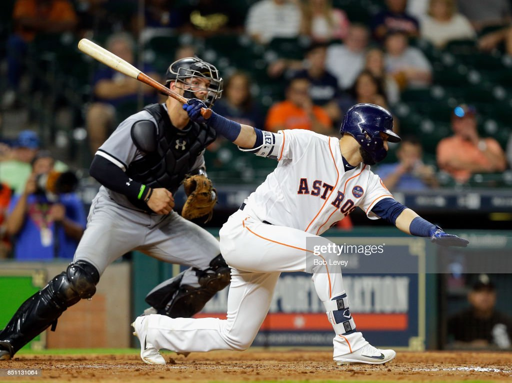 Marwin Gonzalez #9 of the Houston Astros strikes out in the ninth inning as Kevan Smith #36 of the Chicago White Sox looks on at Minute Maid Park on September 21, 2017 in Houston, Texas.