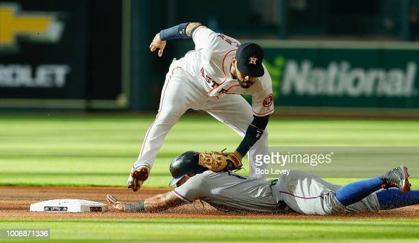Marwin Gonzalez of the Houston Astros tags out Rougned Odor of the Texas Rangers trying to steal second base in the first inning at Minute Maid Park...