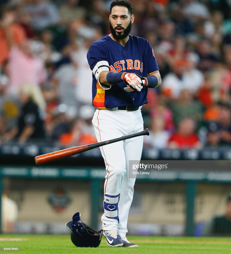 Marwin Gonzalez #9 of the Houston Astros throws his bat and helmet after striking out in the eighth inning against the Oakland Athletics at Minute Maid Park on August 20, 2017 in Houston, Texas.