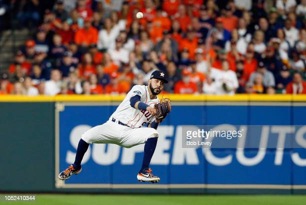 Marwin Gonzalez of the Houston Astros throws out Andrew Benintendi of the Boston Red Sox in the first inning during Game Four of the American League...