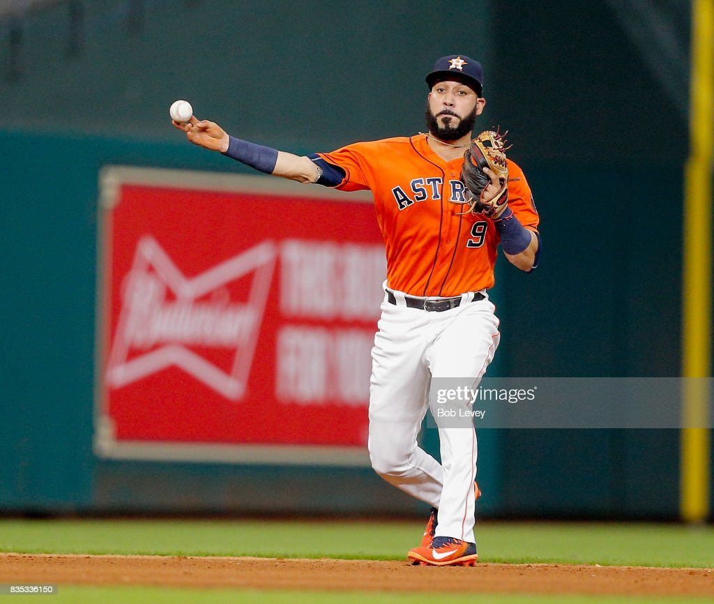 Marwin Gonzalez #9 of the Houston Astros throws out Ryon Healy #25 of the Oakland Athletics in the fifth inning at Minute Maid Park on August 18, 2017 in Houston, Texas.
