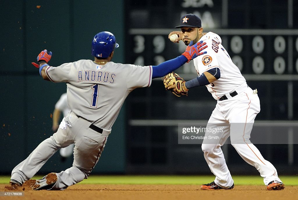 Marwin Gonzalez #9 of the Houston Astros turns a double play as Elvis Andrus #1 of the Texas Rangers slides in to second base during the fourth inning at Minute Maid Park on May 4, 2015 in Houston, Texas.
