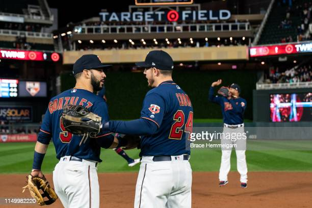 Marwin Gonzalez of the Minnesota Twins celebrates with CJ Cron against the Detroit Tigers in game two of a doubleheader on May 11 2019 at the Target...