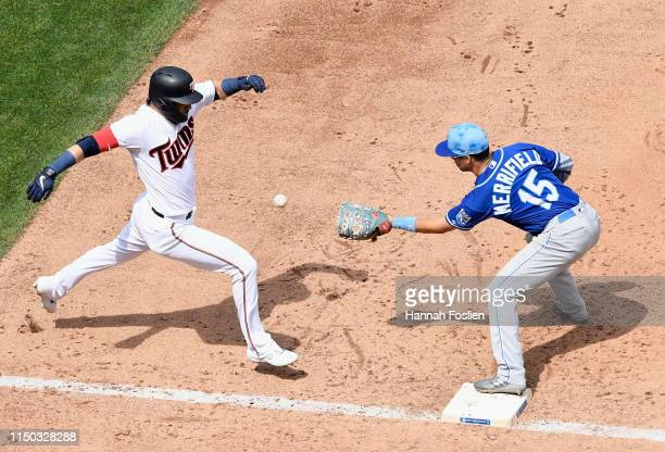 Marwin Gonzalez of the Minnesota Twins is out at first base as Whit Merrifield of the Kansas City Royals fields the ball during the fifth inning of...