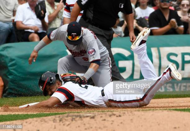 Marwin Gonzalez of the Minnesota Twins tags out Jose Rondon of the Chicago White Sox at third base during the second inning at Guaranteed Rate Field...