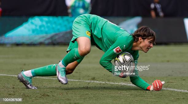 Marwin Hitz goalkeeper for Borussia Dortmund covers a shot on goal from Liverpool during an International Champions Cup match at Bank of America...