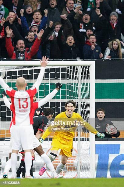 Marwin Hitz Goalkeeper of Augsburg celebrates after scoring a goal during the Bundesliga match between FC Augsburg and Bayer 04 Leverkusen at SGL...