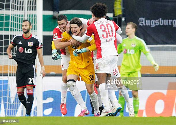 Marwin Hitz Goalkeeper of Augsburg scores a goal during the Bundesliga match between FC Augsburg and Bayer 04 Leverkusen at SGL Arena on February 21...