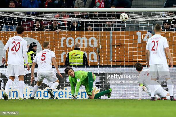 Marwin Hitz keeper of Augsburg safes the ball with during the Bundesliga match between FC Augsburg and Eintracht Frankfurt at WWK Arena on January 30...