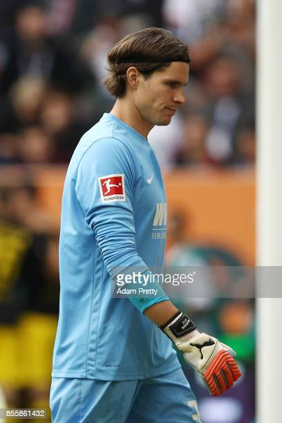 Marwin Hitz of Augsburg looks dejected after Andrej Yarmolenko of Dortmund scored Dortmond's first goal to make it 11 during the Bundesliga match...