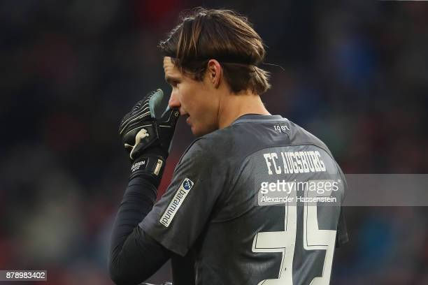 Marwin Hitz of Augsburg looks dejected after he wasn't able to save a goal against Wolfsburg to make it 10 during the Bundesliga match between FC...