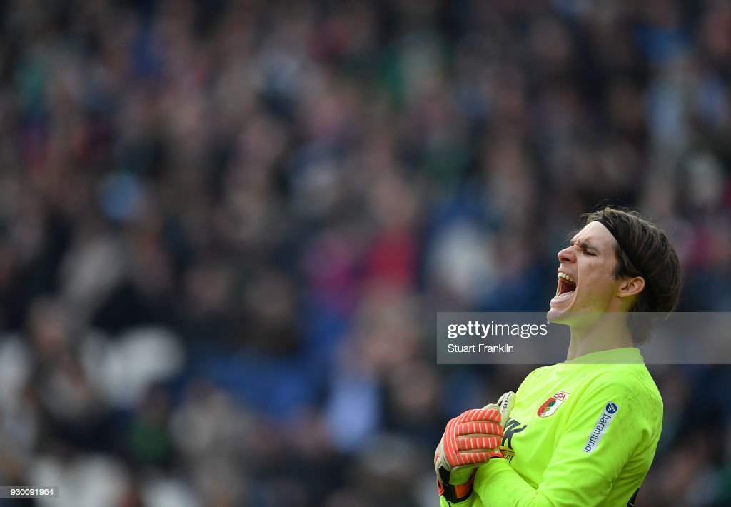 Marwin Hitz of Augsburg shouts during the Bundesliga match between Hannover 96 and FC Augsburg at HDI-Arena on March 10, 2018 in Hanover, Germany.
