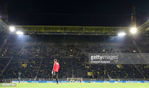 Marwin Hitz of Augsburg warms up in front of an almost empty south stand that normally holds 26000 fans as the fans make their protest against monday...