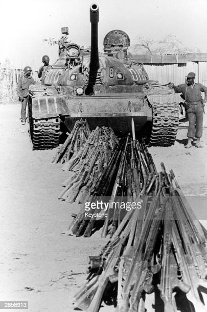 Marxist Ethiopian forces with a Russian T54 tank guard quantities of captured Somali rifles at an army camp in Ethiopia