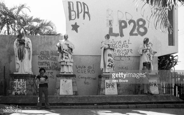 Marxist militants of the Popular Revolutionary Block and Popular Leagues of February 28 occupy Iglesia el Rosario Political graffiti reads 'Stop the...