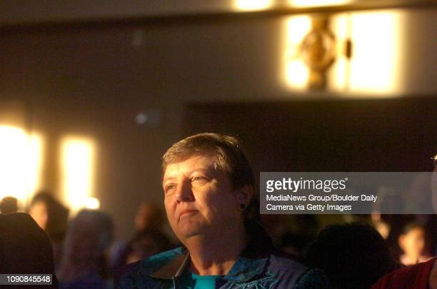 Mary Amundsen twin sister of Father Bob Amundsen listens to readings during the dedication of the Immaculate Conception Catholic Church in Lafayette...
