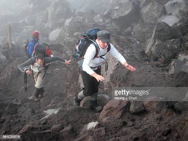 Mary and Brian Racciato of Olympia Washington negotiate the boulders during a guided hike to the summit of Mount St Helens on Saturday September 22...