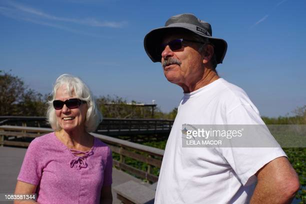Mary and Jack Epperson chat with AFP's reporters on the Anhinga Trail in Everglades National Park in Homestead, Florida, on January 16, 2019. - Four...