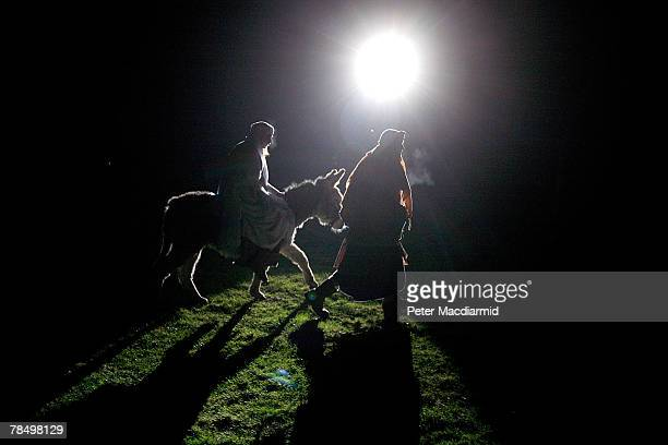 Mary and Joseph ride a donkey to Bethlehem in a performance of the nativity story at the Wintershall Estate Organic farm on December 14 2007 near...