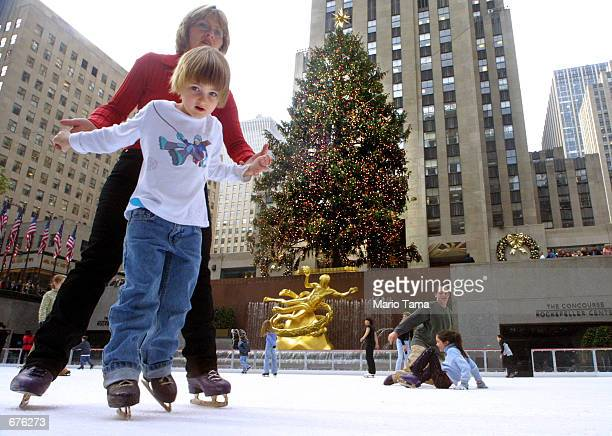 Mary Anderson and her 4yearold daughter Mary Jane ice skate without jackets in the unseasonably warm weather at the Rockefeller Center ice skating...