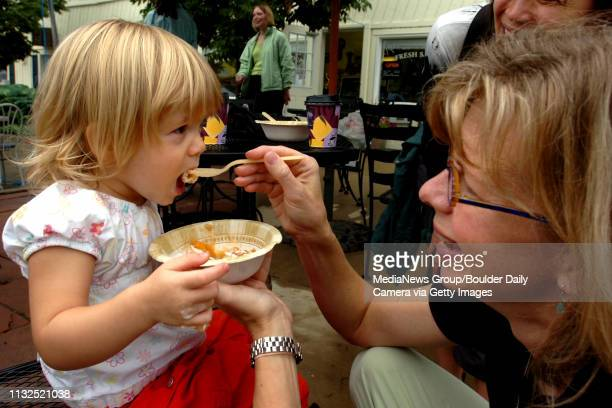 Mary Ann Davis feeds her daughter Isabella some fresh peach cobbler at the Lafayette Peach Festival.The seventh annual Lafayette Peach Festival...