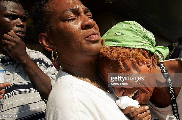 Mary Ann Dixon weeps as she hears that she will be separated from her children on buses leaving the Superdome September 2, 2005 in New Orleans,...
