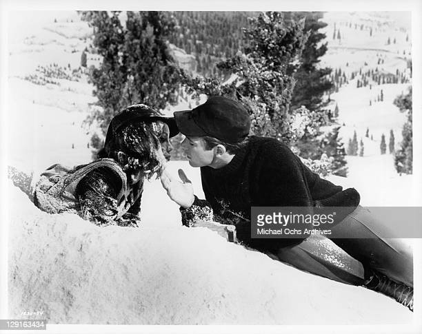 Mary Ann Mobley And Chad Everett kiss in the snow in a scene from the film 'Get Yourself A College Girl' 1964