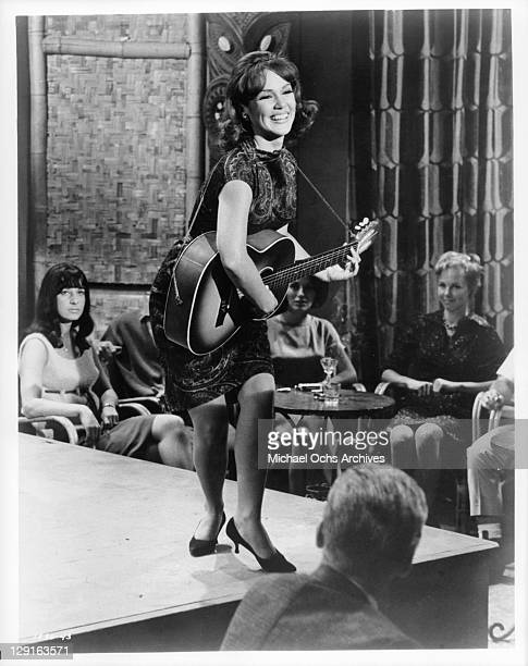 Mary Ann Mobley playing guitar in a scene from the film 'Get Yourself A College Girl' 1964