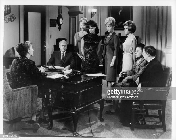 Mary Ann Mobley with other actors gather in office in a scene from the film 'Get Yourself A College Girl' 1964