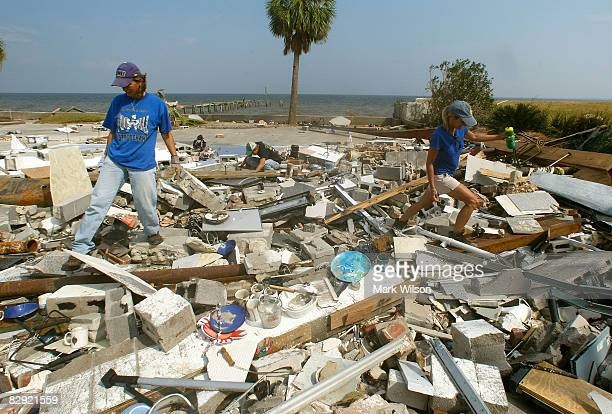 Mary Anne Schmitz and Kay Hoffman look for items in the rubble where Schmitz's beach home once stood before Hurricane Ike demolished it September 19...