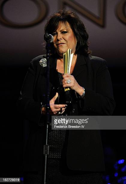 Mary Arnold accepts the Poet's Award on behalf of her late husband Roger Miller at the 6th Annual ACM Honors at Ryman Auditorium on September 24 2012...