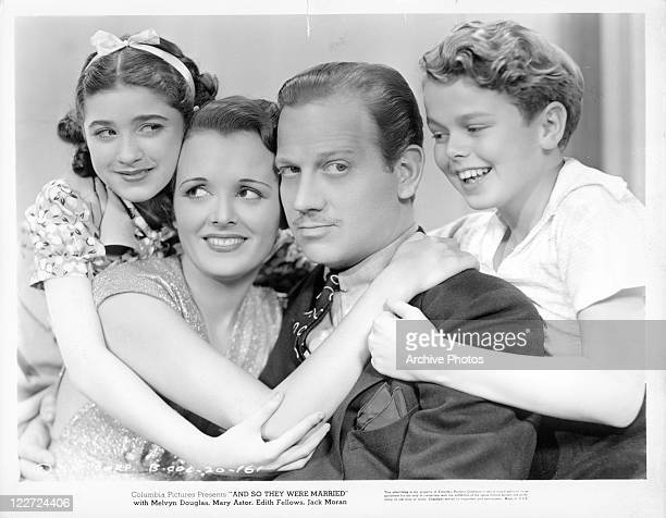Mary AstorMelvyn Douglas and two children are all embracing one another in a scene from the film 'And So They Were Married' 1936