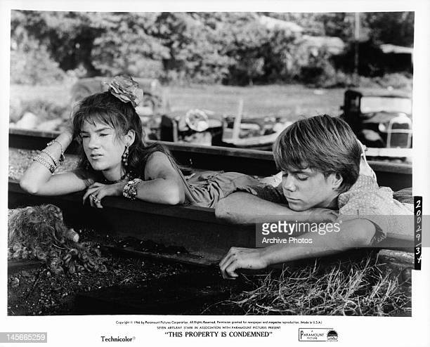 Mary Badham and boy hanging on the railroad tracks in a scene from the film 'This Property Is Condemned' 1966