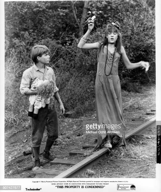 Mary Badham and Jon Provost walks on train track in a scene from the Paramount Pictures movie This Property Is Condemned circa 1966
