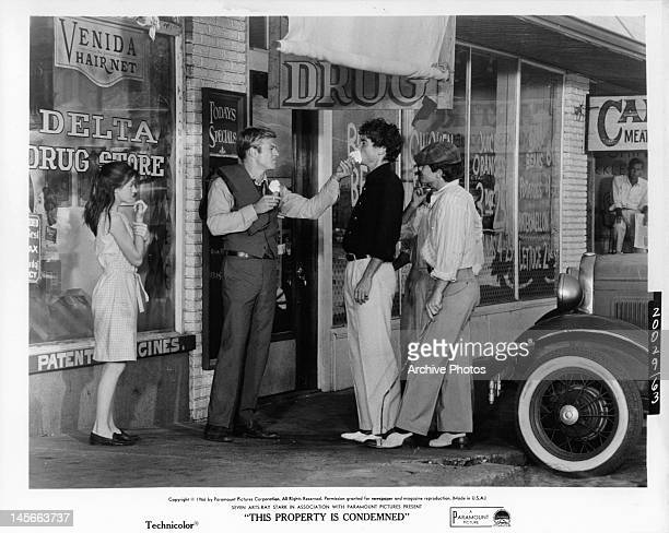 Mary Badham watching as Robert Redford shoves ice cream in guy's face in a scene from the film 'This Property Is Condemned' 1966