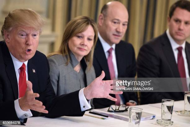 Mary Barra CEO of General Motors Gary Cohn President of President of Goldman Sachs and Doug McMillon CEO of Walmart listen while US President Donald...
