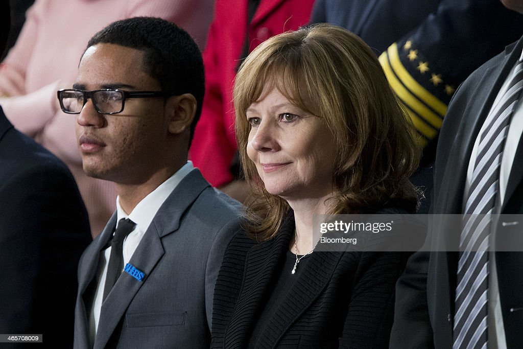 Mary Barra, chief executive officer of General Motors Co. (GM), right, and Estiven Rodriguez, a student at Washington Heights Expeditionary Learning School (WHEELS), listen as U.S. President Barack Obama, not pictured, delivers the State of the Union address to a joint session of Congress at the Capitol in Washington, D.C., U.S., on Tuesday, Jan. 28, 2014. Obama offered modest steps to chip away at the country's economic and social challenges in a State of the Union address that reflects the limits of his power to sway Congress. Photographer: Andrew Harrer/Bloomberg via Getty Images