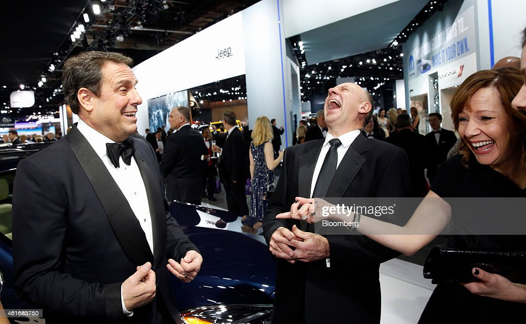 Mary Barra, chief executive officer of General Motors Co. (GM), right, Barra's husband Tony, center, and Mark Reuss, executive vice president of global product development at GM, laugh at the Charity Preview for North American International Auto Show (NAIAS) in Detroit, Michigan, U.S., on Friday, Jan. 16, 2015. Since 1976, the Charity Preview has raised more than $100 million for Southeastern Michigan children's charities. Photographer: Jeff Kowalsky/Bloomberg via Getty Images