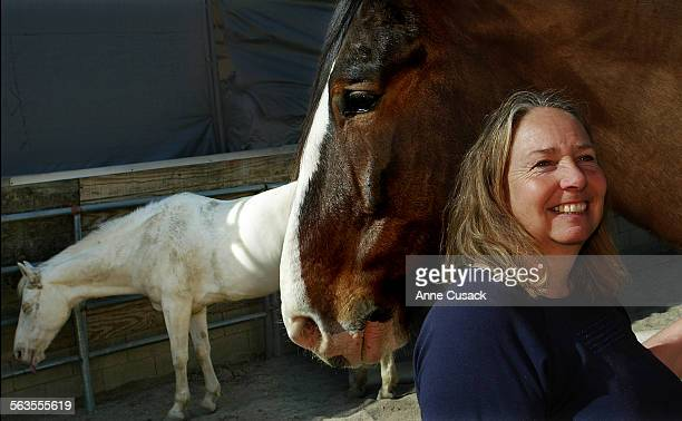 Mary Benson with her horse named Vladimir and Sierra's Gold in the background in her backyard in Sun Valley She hopes to preserve the equestrian area...