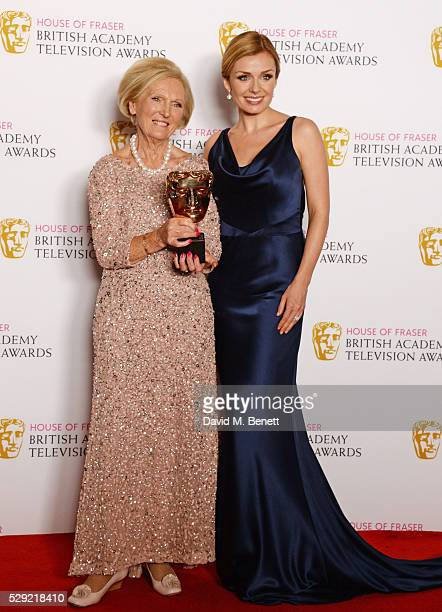 Mary Berry accepting the Feature award for The Great British Bake Off and Katherine Jenkins pose in the winners room at the House Of Fraser British...
