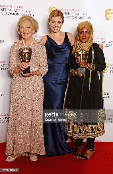 Mary Berry accepting the Feature award for The Great British Bake Off presenter Katherine Jenkins and Bake Off winner Nadiya Hussain pose in the...