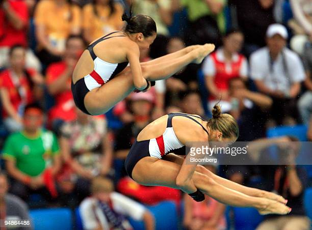 Mary Beth Dunnichay right and Haley Ishimatsu both of the US hold a pike in the women's 10meter synchronized diving event during day four of the 2008...