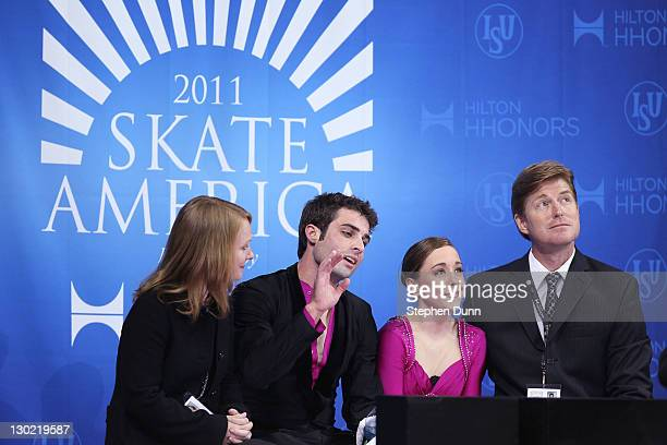 Mary Beth Marley and Rockne Brubaker with Coach Jenni Meno and Todd Sand far in the Kiss and Cry after their performance in Pairs Free Skating during...