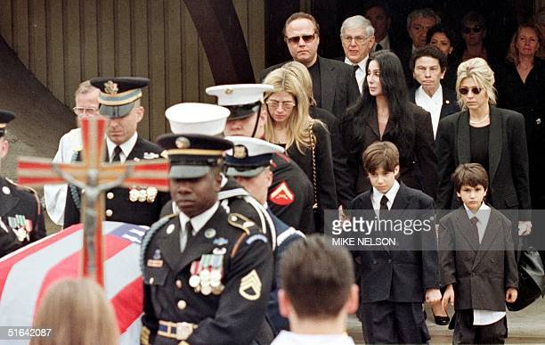 Mary Bono and her son Chesare accompanied by Cher walk behind the casket of her husband Sonny Bono 09 January following a Catholic service in Palm...