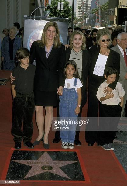Mary Bono and kids Chianna and Cesare Chasity Bono and Christy Bono and son