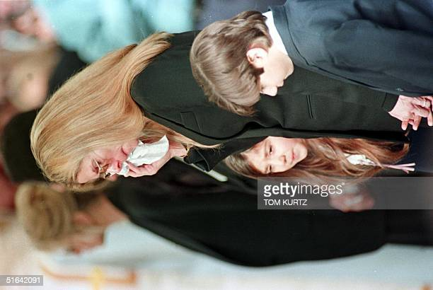 Mary Bono widow of deceased US Congressman Sonny Bono wipes her tears during Bonos's funeral 09 January in Cathedral City CA She is surrounded by...