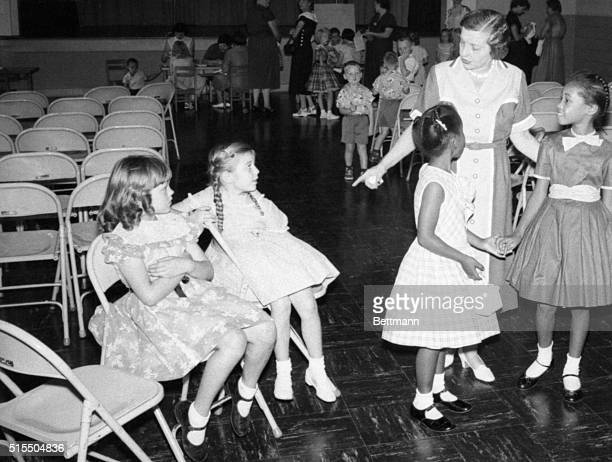 Mary Brent principal of the Glenn school greets white and Negro pupils during registration in the first grade of the Nashville city schools August...